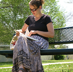 Picture of woman sitting on bench studying